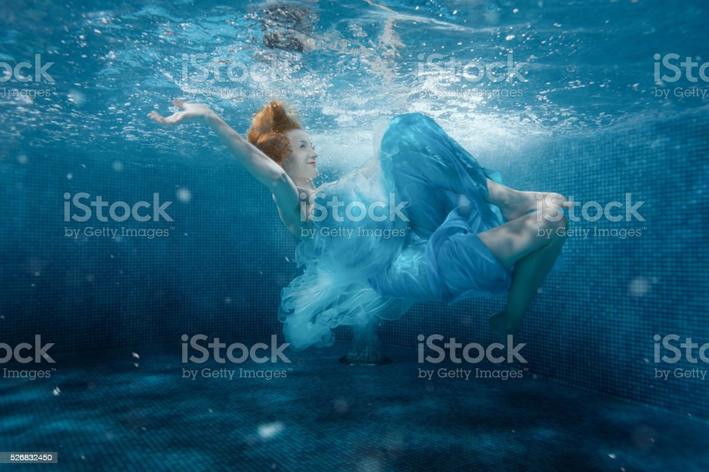 Girl from the fairy tale under water. stock photo