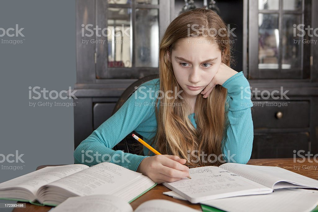Girl Frustrated Doing Homework royalty-free stock photo