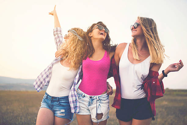 girl gang - hippie fashion stock photos and pictures