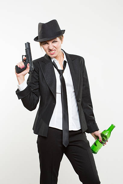 girl gangster holding a gun. Classic suit and hat. – Foto