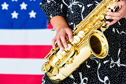 Girl Gets Her Groove On Woman Playing Alto Sax Stock Photo
