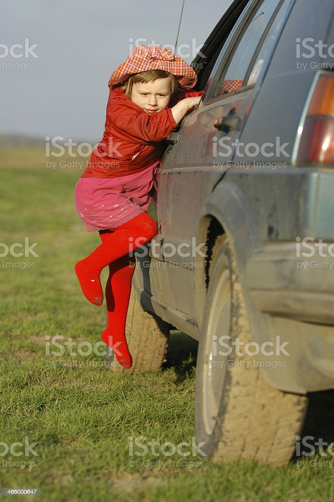 Girl gets out the car window stock photo