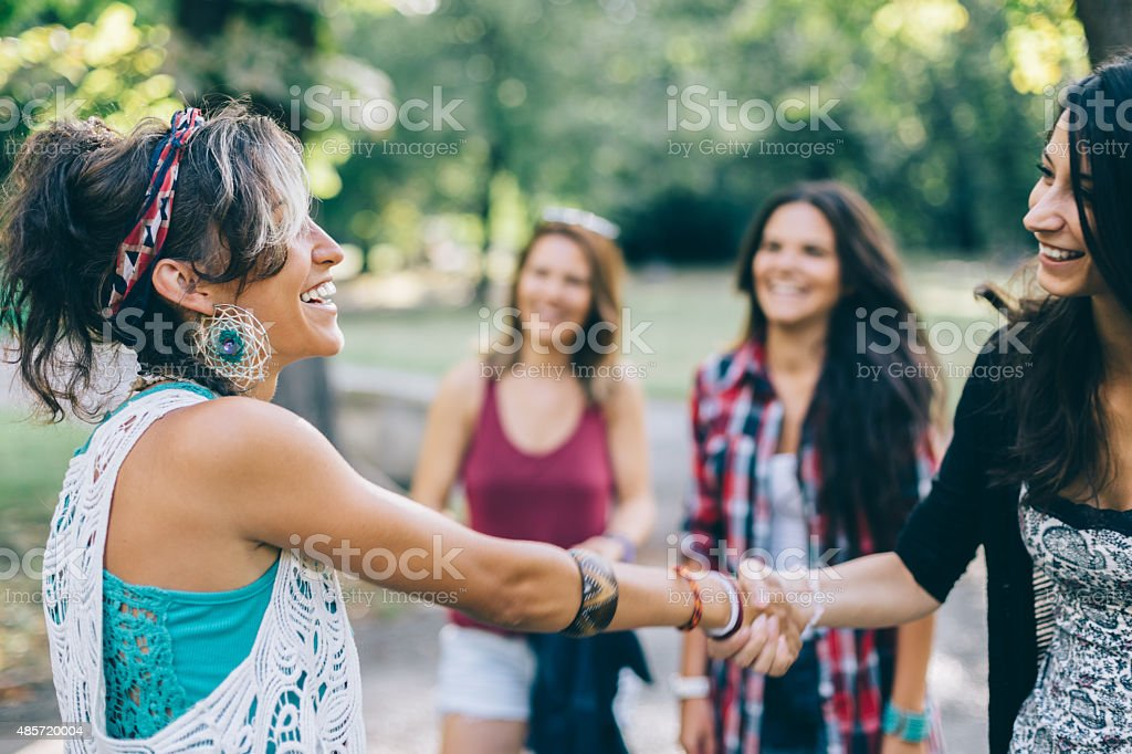 Girl getting acquainted to a new person stock photo
