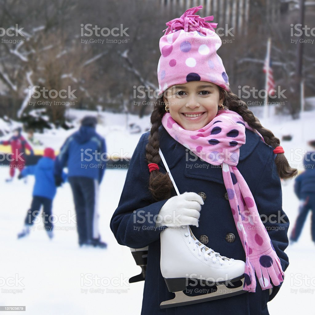 Girl getting ready to go ice skating royalty-free stock photo