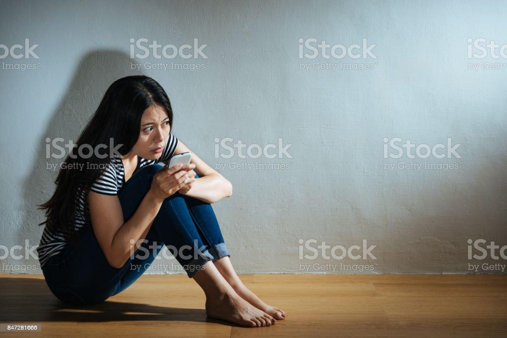 girl getting violence problem sitting in dark stock photo