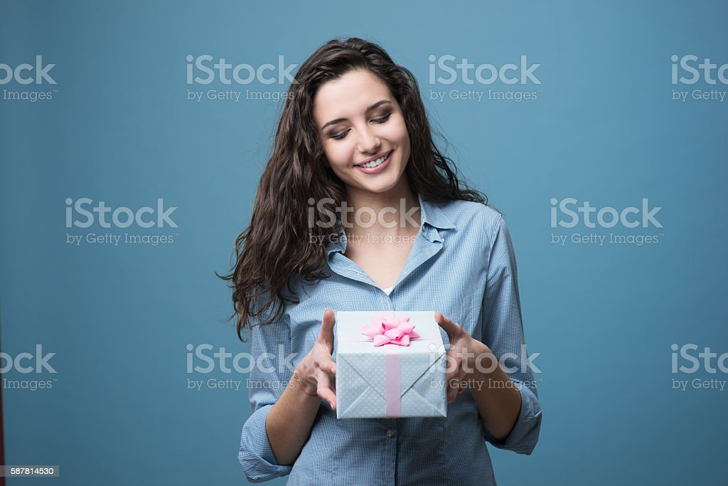 Girl giving a beautiful gift stock photo