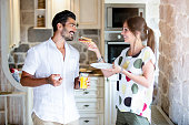 Girl giving her boyfriend a sandwich