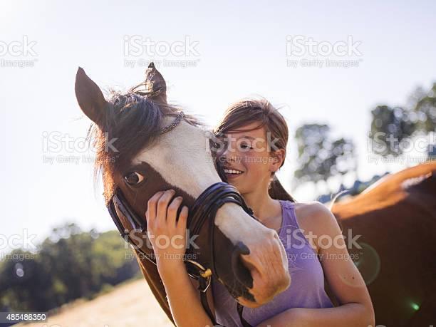 Girl giving her horse a friendly hug outdoors picture id485486350?b=1&k=6&m=485486350&s=612x612&h=9nid9gzjtjcafz vschlzypmiw8whvdni32ysddw xo=