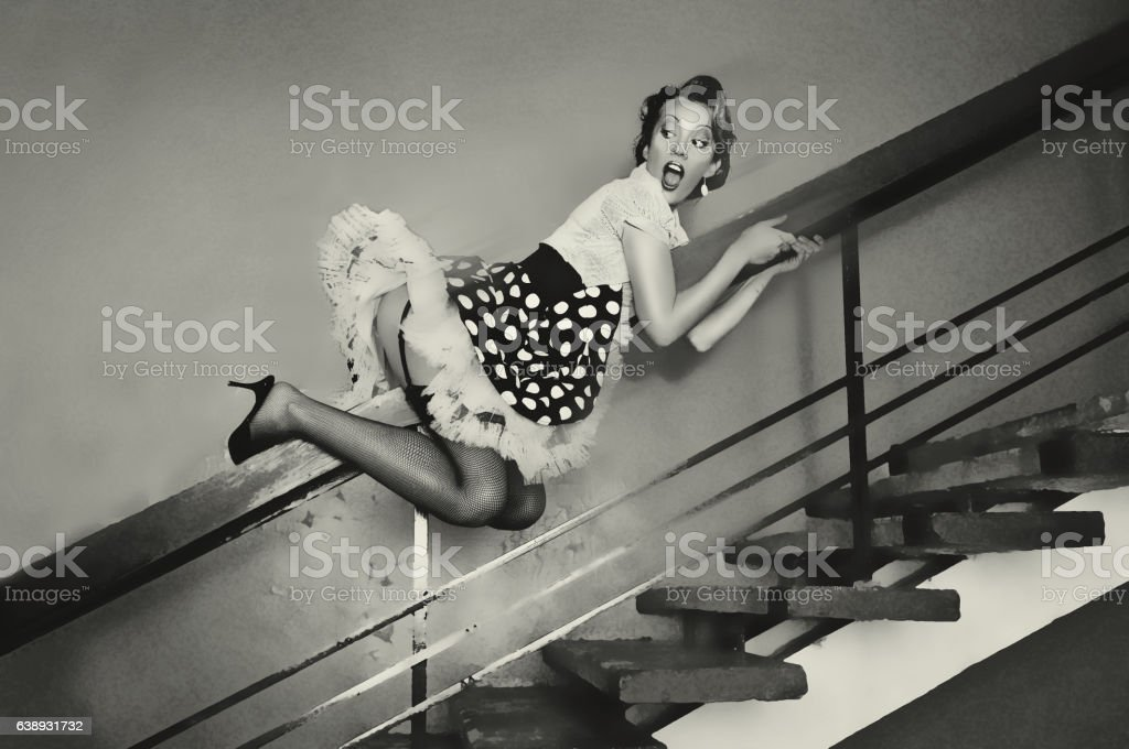 Girl goes down the banisters stock photo