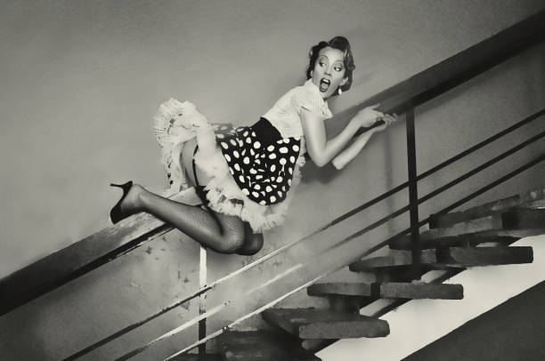 girl goes down the banisters - pin up girl stock pictures, royalty-free photos & images