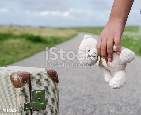 Girl goes with her teddybear on the road