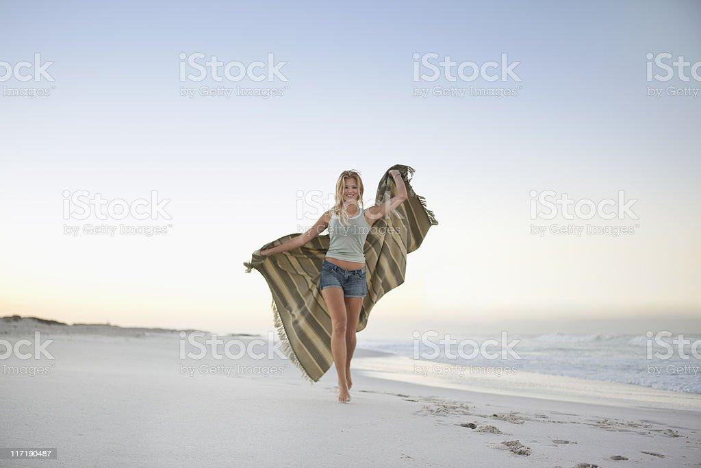 Girl going on beach stock photo