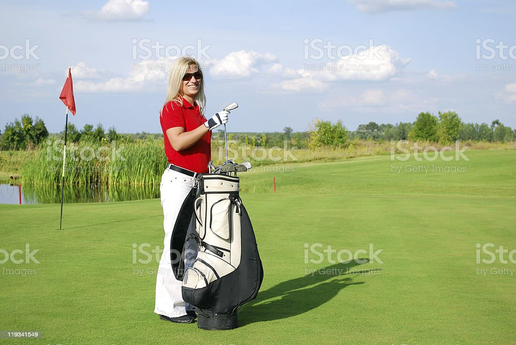 girl golf player with bag royalty-free stock photo