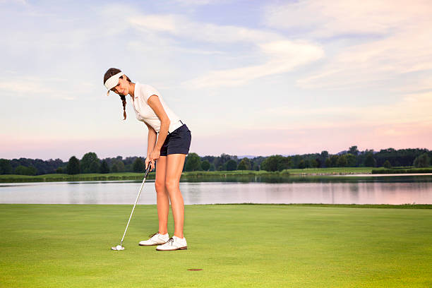 Girl golfer putting. stock photo