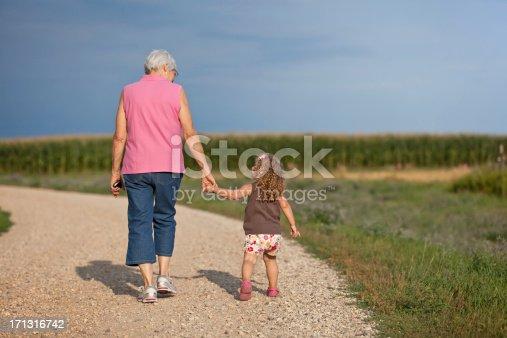istock Girl & Grandma Going for Walk on Farm 171316742
