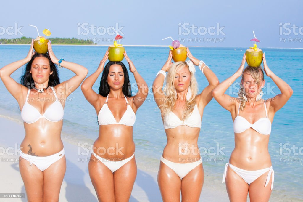 Girl group on the beach in the Maldives stock photo