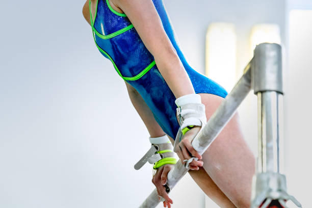 girl gymnast athlete during an exercise horizontal bar in gymnastics competitions stock photo