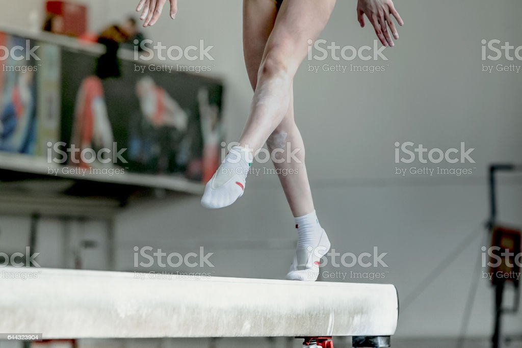 girl gymnast athlete during exercise on balance beam in gymnastics competitions stock photo