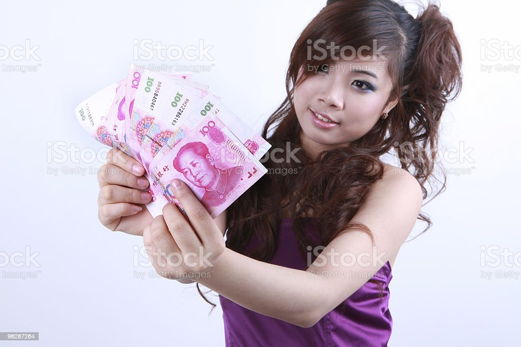 Girl hand holding the RMB royalty-free stock photo