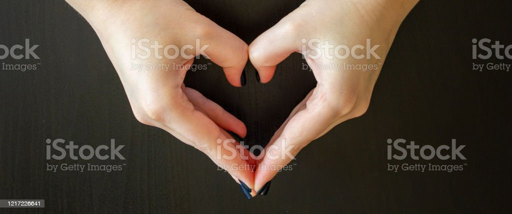 Girl Hand In Heart Form Love On Dark Background Stock Photo Download Image Now Istock