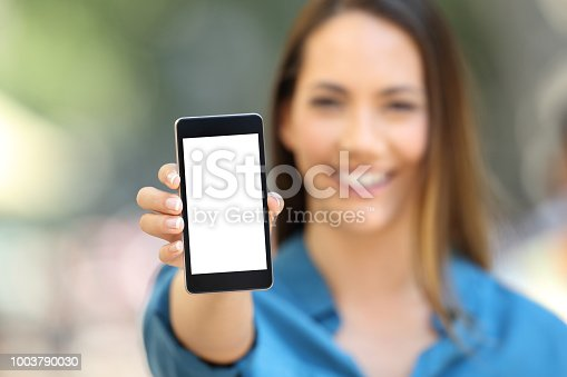 istock Girl hand showing a phone screen mock up 1003790030