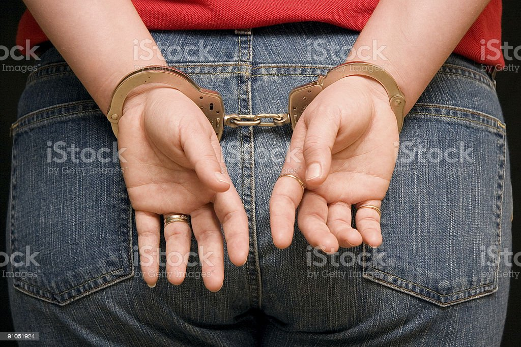 Girl Handcuffed 1 royalty-free stock photo