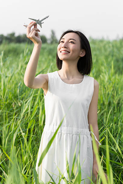 girl hands holding model airplane stock photo