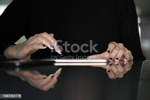 Front view on girl hands moving on the tablet screen