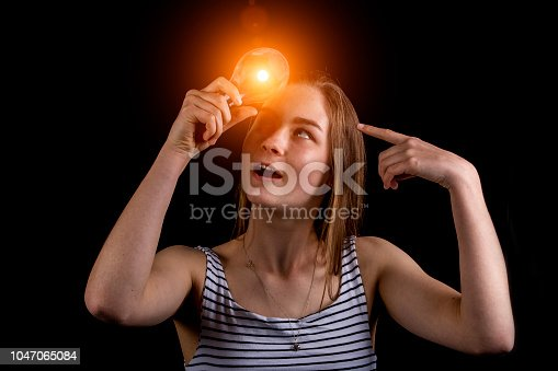 istock Girl has a light bulb moment 1047065084