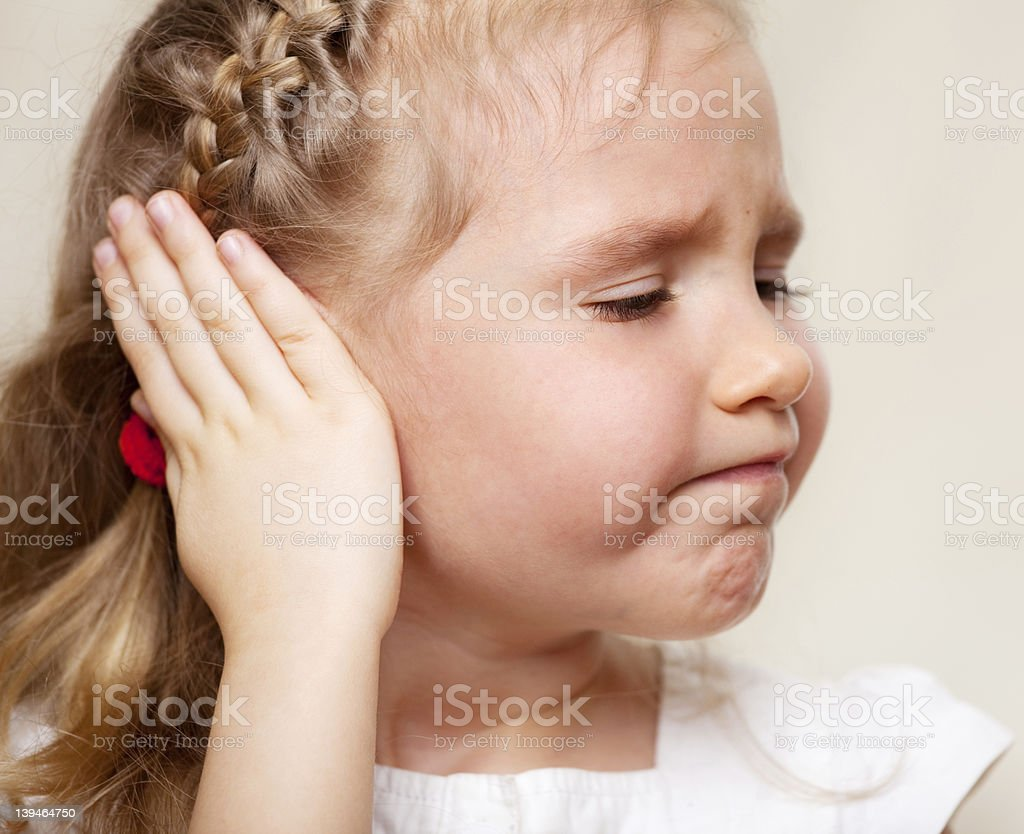 Girl has a sore ear royalty-free stock photo
