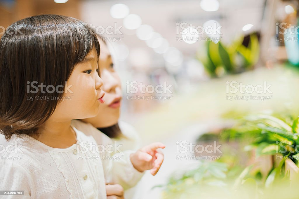 Girl has come to the shopping with mother stock photo