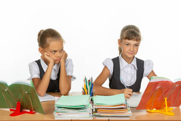 Girl hates looking at a classmate Girl hates looking at a classmate antipode stock pictures, royalty-free photos & images
