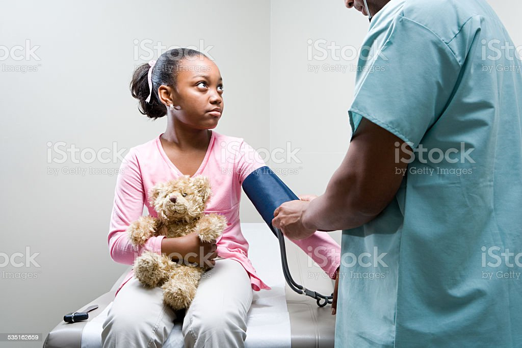 Girl having a check up stock photo