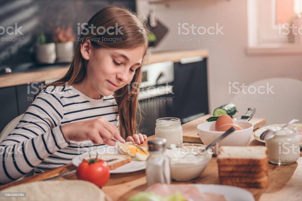 Girl having breakfast at home stock photo