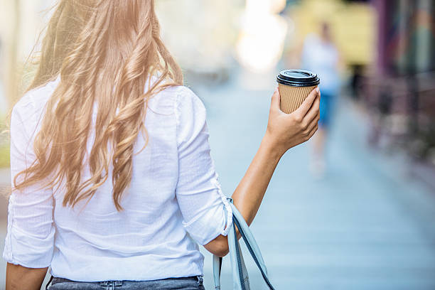 Girl having coffe to go stock photo