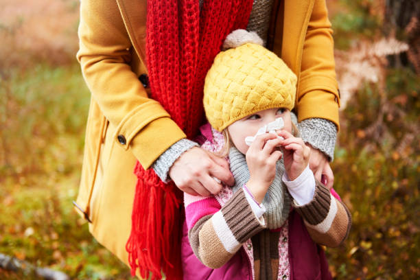 Girl having cold in the autumn stock photo