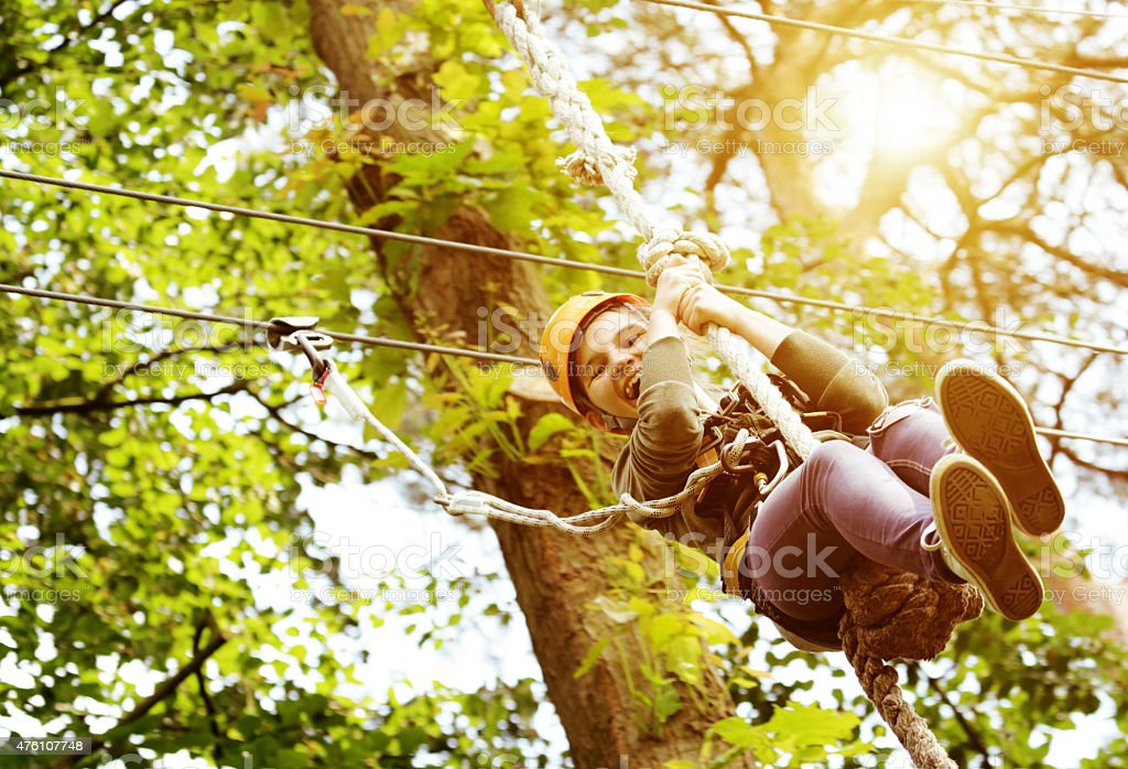 girl having fun in outdoors adventure park stock photo