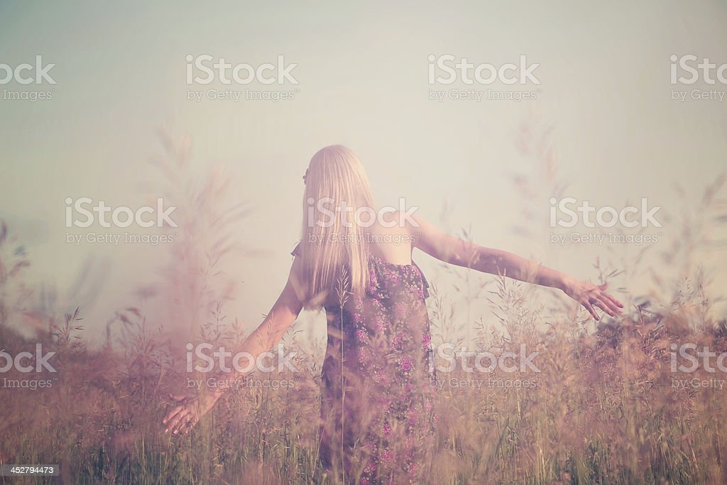 Girl having fun in summer field stock photo