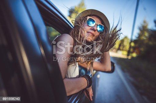 istock Girl having fun on the road trip 691558240