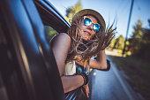 Girl having fun on the road trip