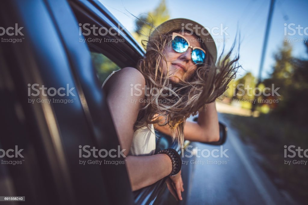 Girl having fun on the road trip stock photo