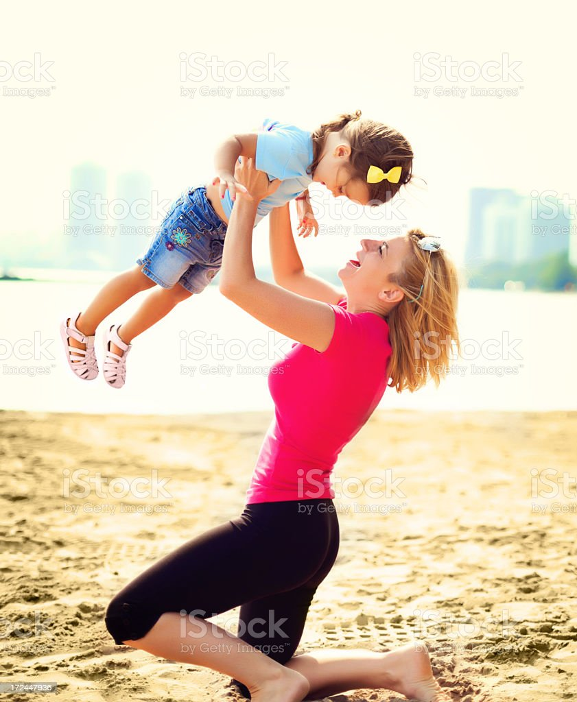 Girl having fun with her mother on a beach royalty-free stock photo