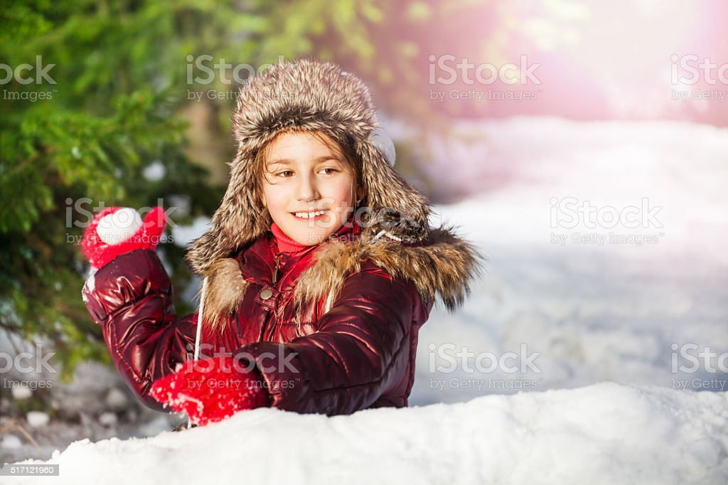 Girl having fun with snowball fight winter outdoor stock photo