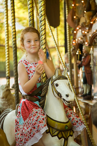 Girl Having Joy Ride On Merry Go Round Stock Photo - Download Image Now