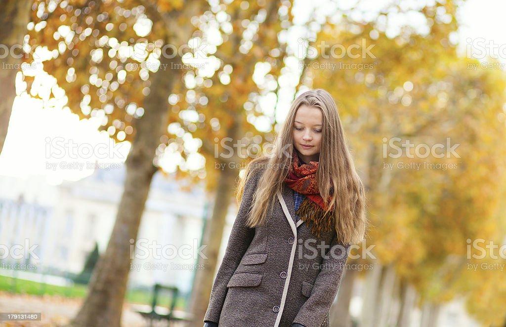 Girl having walking on a beautiful fall day royalty-free stock photo