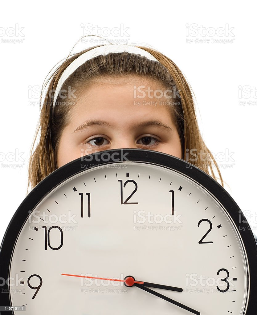 Girl Hiding Behind Clock stock photo