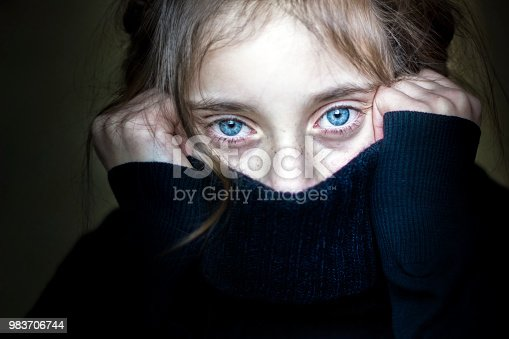 Worried and scared girl hiding her face