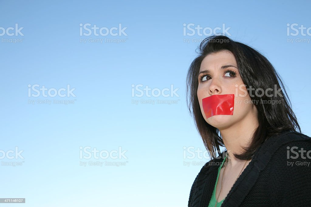 Girl Hiding with Tape on Mouth royalty-free stock photo