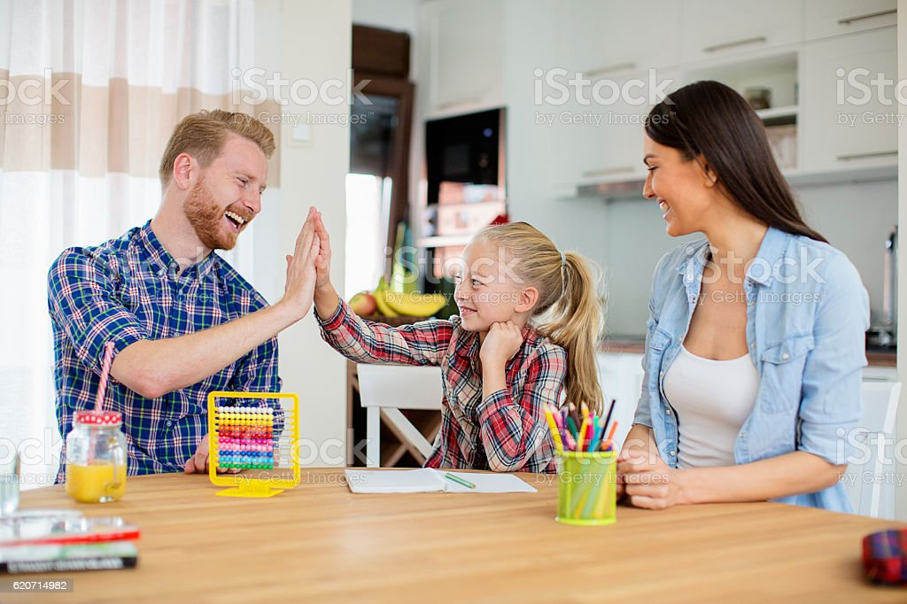 Girl high-fiving her dad stock photo