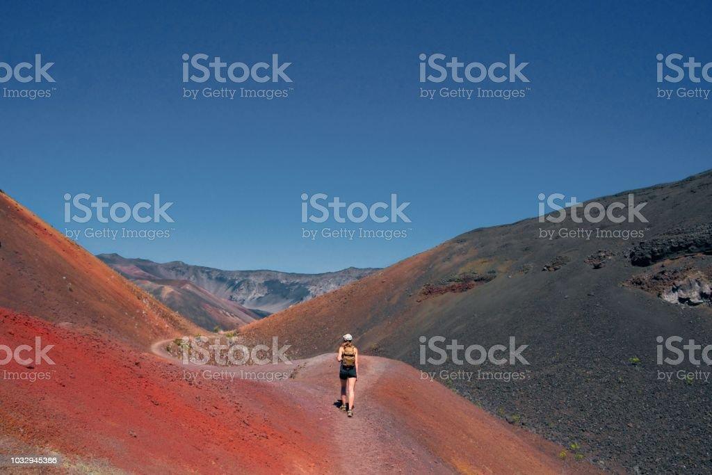 Girl hikes through Haleakalā National Park stock photo